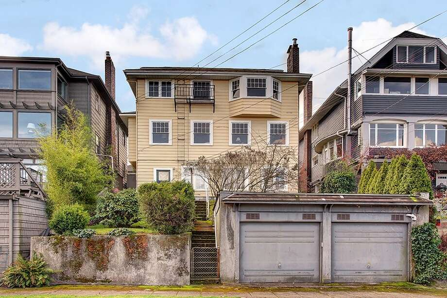 Exterior of 1220 E. Newton St. The 4,130-square-foot house, built in 1919, has four bedrooms, 2.75 bathrooms, built-ins, three fireplaces, French doors, an office and a family room on a 4,000-square-foot lot. It's listed for $958,999. Photo: Vista Estate Imaging, Courtesy Juanita Bunch, Coldwell Banker Bain