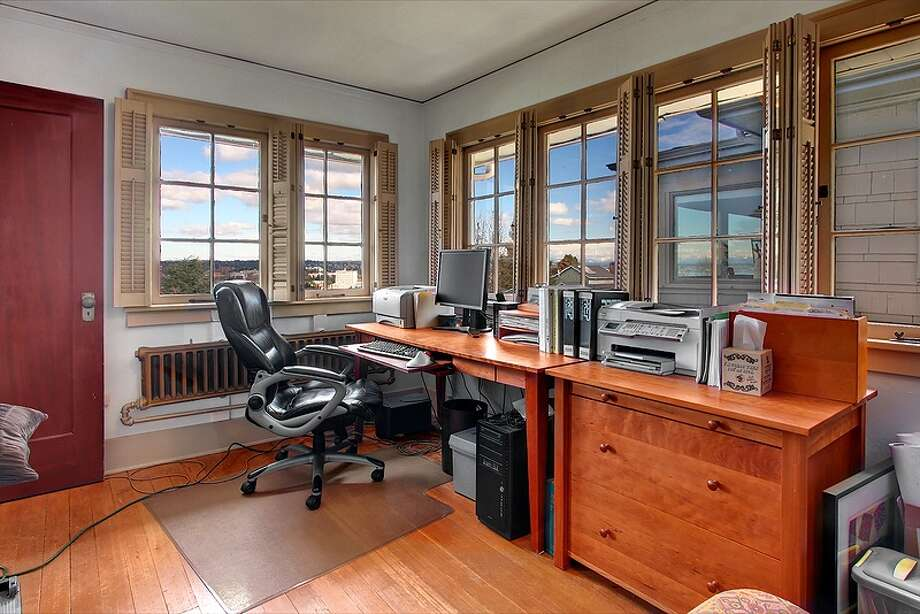 Office of 1220 E. Newton St. The 4,130-square-foot house, built in 1919, has four bedrooms, 2.75 bathrooms, built-ins, three fireplaces, French doors and a family room on a 4,000-square-foot lot. It's listed for $958,999. Photo: Vista Estate Imaging, Courtesy Juanita Bunch, Coldwell Banker Bain