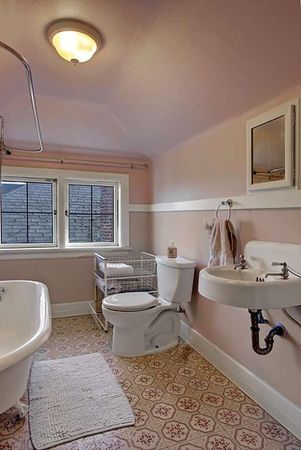 Bathroom of 1220 E. Newton St. The 4,130-square-foot house, built in 1919, has four bedrooms, 2.75 bathrooms, built-ins, three fireplaces, French doors, an office and a family room on a 4,000-square-foot lot. It's listed for $958,999. Photo: Vista Estate Imaging, Courtesy Juanita Bunch, Coldwell Banker Bain