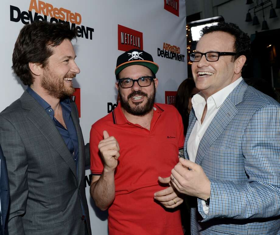 "(L-R) Actors Jason Bateman, David Cross and producer Mitch Hurwitz arrive at the premiere of Netflix's ""Arrested Development"" Season 4 at the Chinese Theatre on April 29, 2013 in Los Angeles, California.  (Photo by Kevin Winter/Getty Images)"