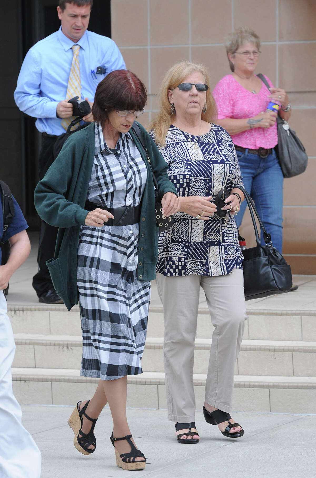 Deborah Ray Holst walks out of the Galveston County Courthouse Tuesday shortly after Bartholomew Granger was found guilty on capital murder charges from the shooting death of Holst's mother Minnie Ray Sebolt. The trial stems from the 2012 Jefferson County Courthouse Shooting. Photo taken Tuesday, April 23, 2013 Guiseppe Barranco/The Enterprise