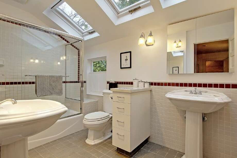 Bathroom of 2833 Broadway E. The 3,706-square-foot house, built in 1909, has five bedrooms, 2.75 bathrooms, a kitchen sitting area, a den, a reading nook, a second kitchen, a wine cellar, a front porch and a deck on a 5,500-square-foot lot. It's listed for $985,000. Photo: Courtesy Jan Selvar, Windermere Real Estate