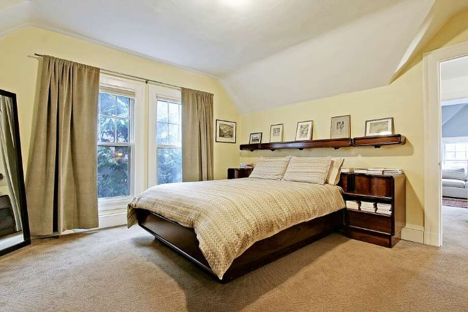 Bedroom of 2833 Broadway E. The 3,706-square-foot house, built in 1909, has five bedrooms, 2.75 bathrooms, a kitchen sitting area, a den, a reading nook, a second kitchen, a wine cellar, a front porch and a deck on a 5,500-square-foot lot. It's listed for $985,000. Photo: Courtesy Jan Selvar, Windermere Real Estate