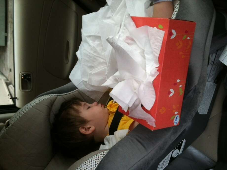Joseph, 11 months, fell asleep in the car. Pulling all those Kleenex out of the box was hard work.