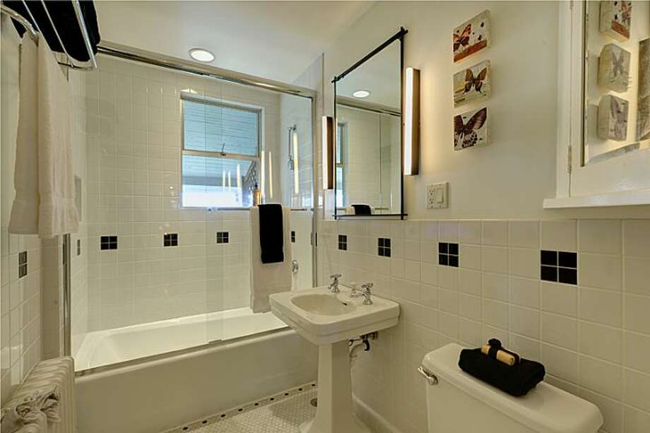Bathroom of 2308 11th Ave. E. The 2,993-square-foot townhouse, built in 1912, has three bedrooms, 2.75 bathrooms, a family room, decks and patios on a 4,500-square-foot lot. It's listed for $979,000. Photo: Courtesy Mimi Bemis, Windermere Real Estate