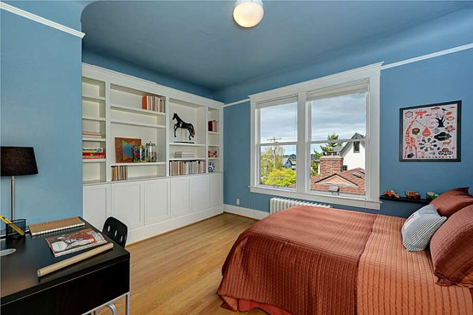 Bedroom of 2308 11th Ave. E. The 2,993-square-foot townhouse, built in 1912, has three bedrooms, 2.75 bathrooms, a family room, decks and patios on a 4,500-square-foot lot. It's listed for $979,000. Photo: Courtesy Mimi Bemis, Windermere Real Estate
