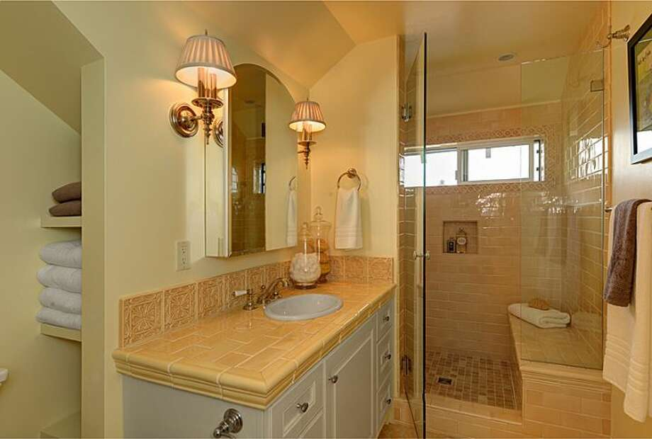 Master bathroom of 2308 11th Ave. E. The 2,993-square-foot townhouse, built in 1912, has three bedrooms, 2.75 bathrooms, a family room, decks and patios on a 4,500-square-foot lot. It's listed for $979,000. Photo: Courtesy Mimi Bemis, Windermere Real Estate