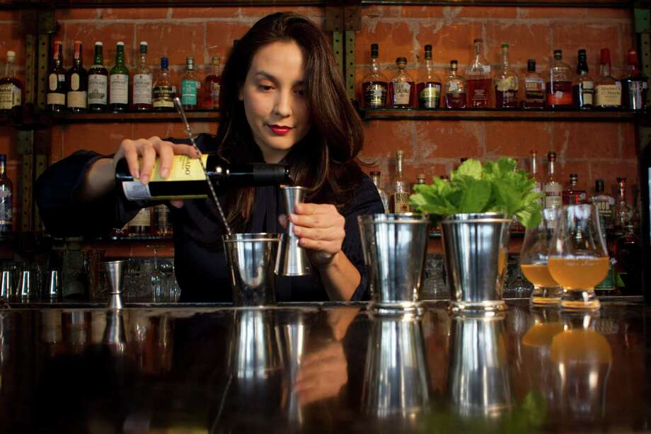 Anvil Bar & Refuge's Alba Huerta mixes a Tenor julep. Photo: Johnny Hanson, Staff / © 2013  Houston Chronicle