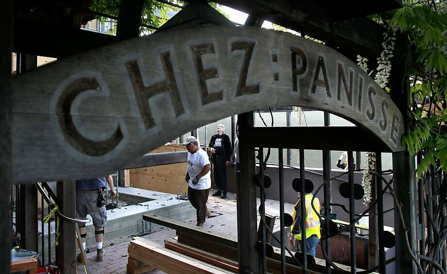 Workers bolt a steel frame to the foundation at the front of Chez Panisse in Berkeley. Photo: Michael Macor, The Chronicle