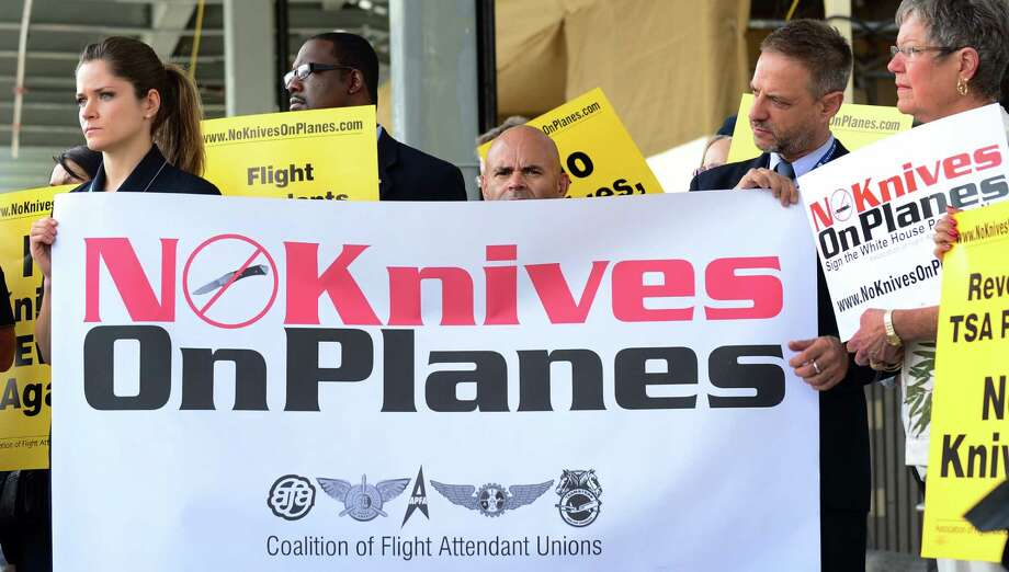 Flight attendants for U.S. airlines picket at Los Angeles International Airport, demanding that small knives be kept out of their flight cabins. The TSA has retreated from plans to allow small pocket knives aboard planes. Photo: Frederic J. Brown / Getty Images