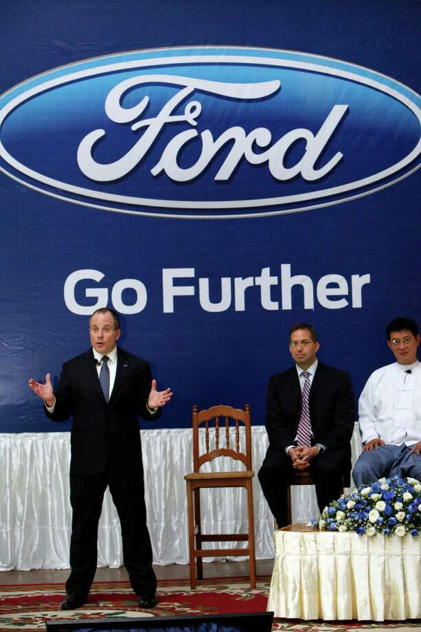 David Westerman, left, a regional manager for Ford Asia Pacific, speaks during their launching ceremony Tuesday, April 30, 2013 in Yangon, Myanmar. Ford Motor Co. announced its entry into Myanmar on Tuesday, saying it plans to open the nation's first sales and service showroom for new vehicles by August. (AP Photo/Khin Maung Win) Photo: Khin Maung Win