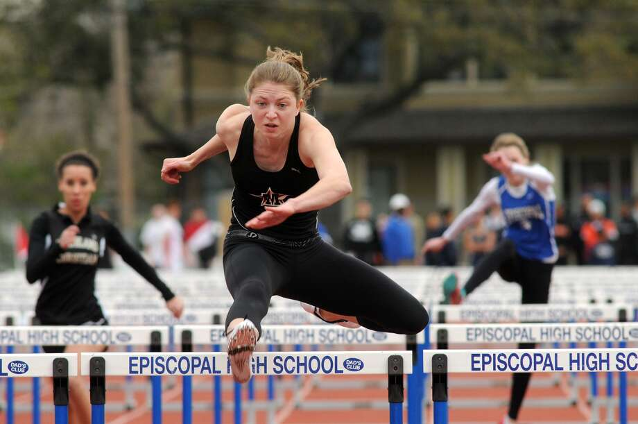 St Johns School junior Jackie Modesett jumps out to big lead in her heat of the Girls 100 Meter Hurdles at the Episcopal High School Relays. Freelance photo by Jerry Baker Photo: Jerry Baker, Freelance