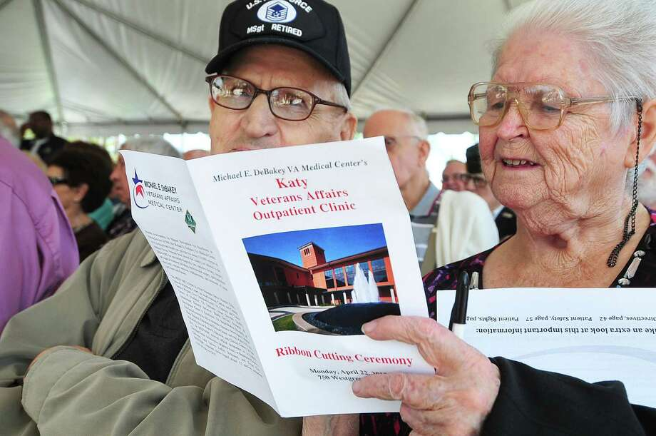 Troy Qualls, 83, and his wife Bertha Qualls, 75, look through the program during the ribbon-cutting ceremony for the new VA Outpatient Clinic in Katy.Troy Qualls, 83, and his wife Bertha Qualls, 75, look through the program during the ribbon-cutting ceremony for the new VA Outpatient Clinic in Katy. Photo: Â Tony Bullard 2013, Freelance Photographer / © Tony Bullard & the Houston Chronicle