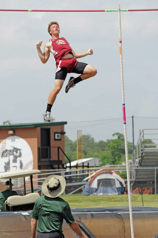 Cy Woods sophomore Travis Toliver was on his way to the mat and a gold medal in the Class 5A Region III boys pole vault in Humble last week. Photo: L. Scott Hainline / Freelance