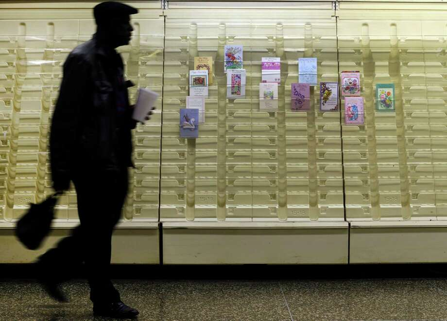 In this April 27, 2013 photo, a man walks past a greeting cards display case in a market in Baltimore.The private Conference Board reports on consumer confidence for April on Tuesday, April 30, 2013 (AP Photo/Patrick Semansky) Photo: Patrick Semansky