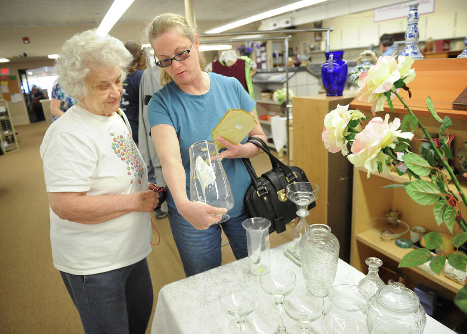 Bonnie Adams and her daughter Sylvia Stunkel, both of Stamford, shop for vases at My Sister's Place, a thrift store at 380 Main Street in Ansonia, Conn. on Monday, April 30, 2013. The store, whose proceeds benefit victims of domestic violence, recently reopened in the aftermath of a fire at a nightclub next door. Photo: Brian A. Pounds / Connecticut Post