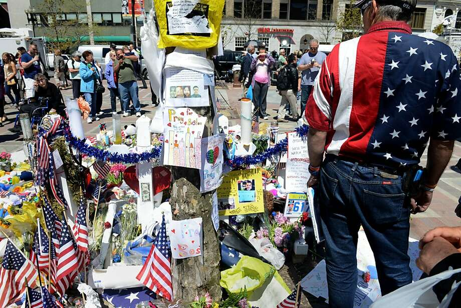 The memorial site at Copley Square continues to attract visitors as the city gets back to normal two weeks after the bombings at the finish line of the Boston Marathon. Photo: Darren McCollester, Getty Images