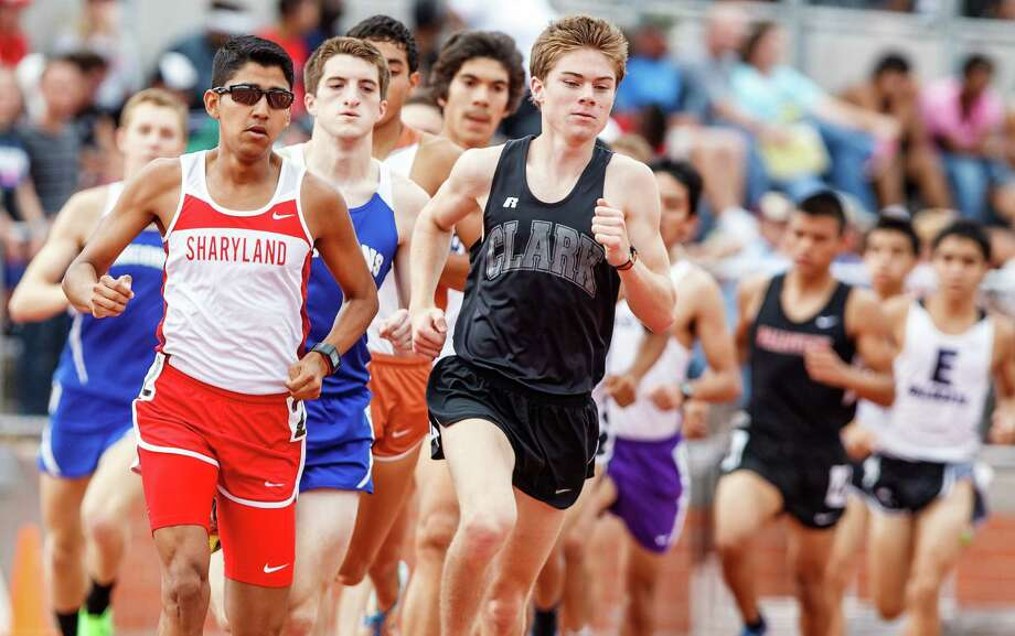 Clark's Austin Wells leads the second lap of the 1,600-meter run during the Region IV-4A/5A track meet at Heroes Stadium on Saturday. Wells won both the 1,600 and the 3,200 events.