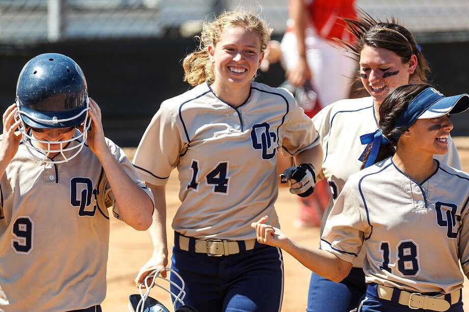 O'Connor's Sarah Worrell (center), shown smiling during a March 14 game with Taft, was happier still with a walk on Friday when her patience rewarded her, and the Panthers, with a win.
