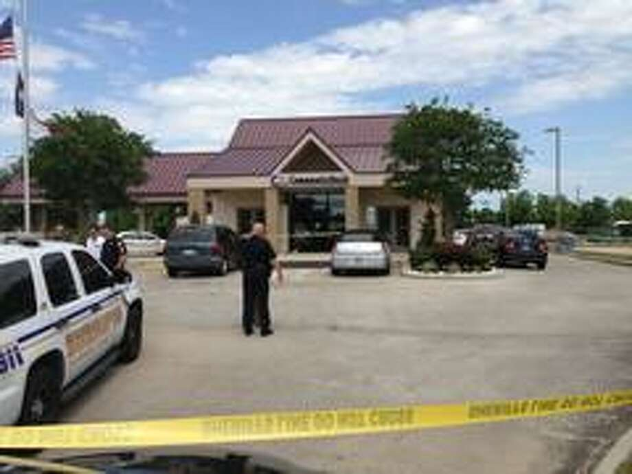Harris County sheriff's deputies investigate the daylight robbery Tuesday of Community Bank of Texas in Crosby. Photo: Harris County SO