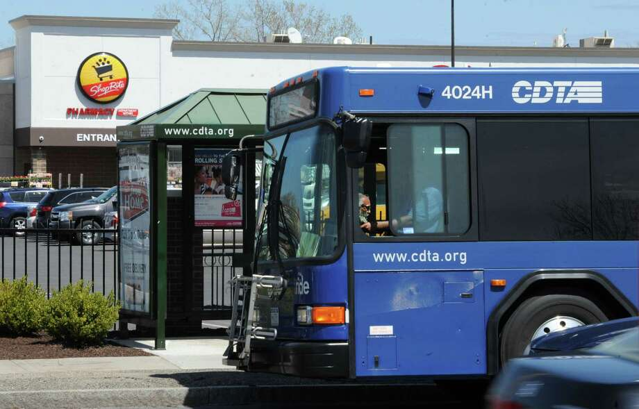A CDTA bus pulls up to a bus stop in front of the ShopRite on Central Ave. on Tuesday, April 30, 2013 in Albany, N.Y.  Transit authority has seen ridership climb thanks in large part to its universal access program, which has encouraged people who get bus passes as an employee perk to use them for more than just commuting. ShopRite encourages this program with their employees.  (Lori Van Buren / Times Union) Photo: Lori Van Buren / 10022227A