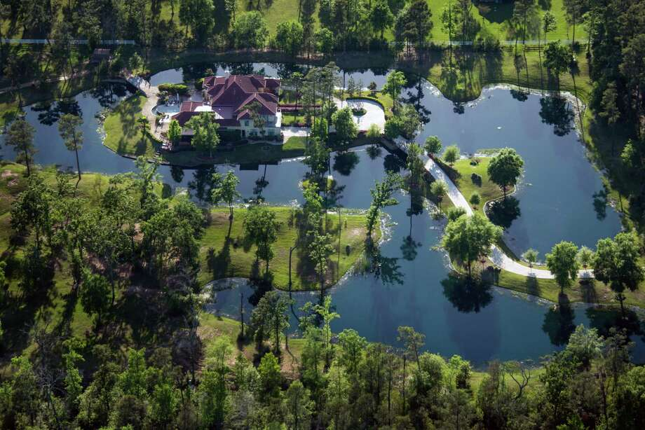 Gallegos lived quietly for seven years in self-imposed exile near The Woodlands in a mansion complete  with a moat. Photo: Smiley N. Pool, Houston Chronicle / © 2013  Houston Chronicle