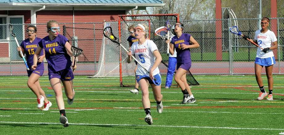 Danbury High schools Lindsey Eanniello has possession of the ball during a girls lacrosse game against Westhill at Danbury, Conn on Tuesday April, 30, 2013. Photo: Lisa Weir / The News-Times Freelance