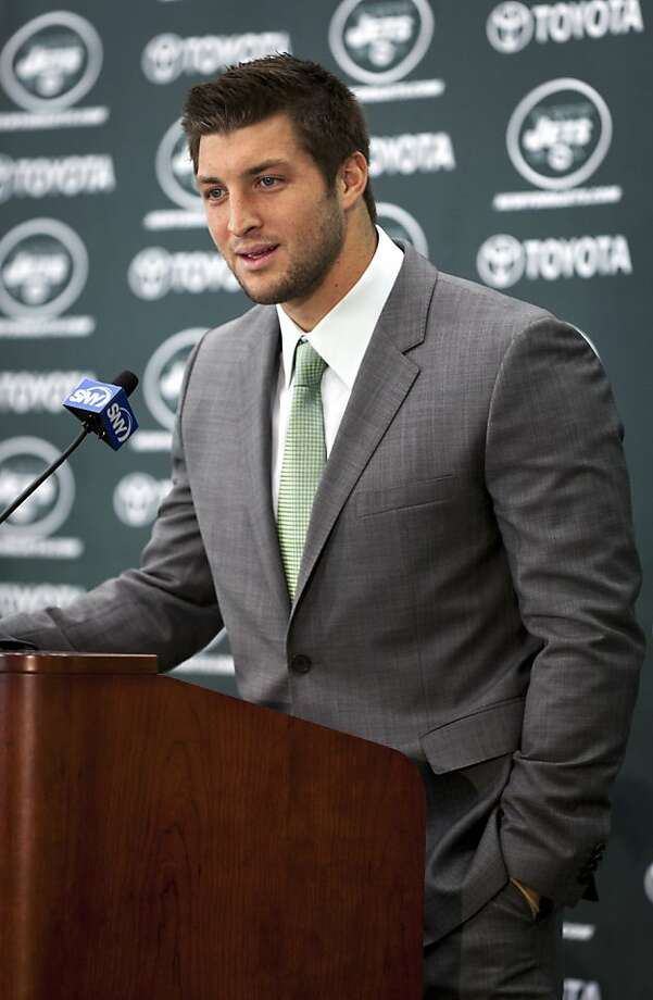 FILE -- Tim Tebow speaks at a news conference after being introduced as a quarterback for the New York Jets in Florham Park, N.J., on March 26, 2012. The Jets cut Tebow on Monday April 29, 2013, after drafting Geno Smith on Friday, which raised the number of quarterbacks on their roster to six. (Richard Perry/The New York Times) Photo: Richard Perry, New York Times