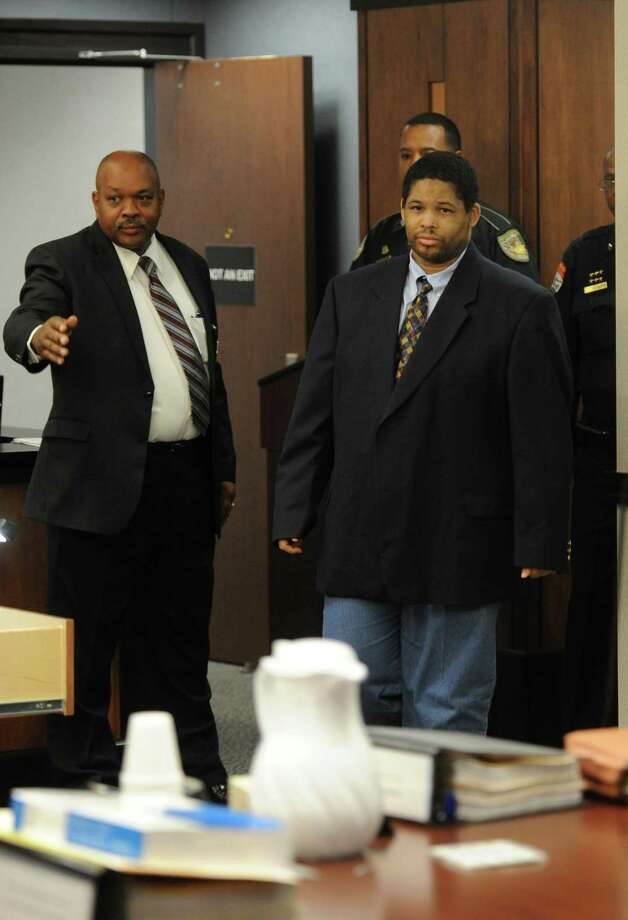 Bartholomew Granger, right, enters the Galveston County courtroom shortly before closing arguments on Tuesday, April 30, 2013, in Galveston, Texas. Jurors returned their guilty verdict for the shooting death of Minnie Ray Sebolt after about one hour and 45 minutes of deliberations.  (AP Photo/The Beaumont Enterprise,Guiseppe Barranco) Photo: Guiseppe Barranco, MBO / The Beaumont Enterprise