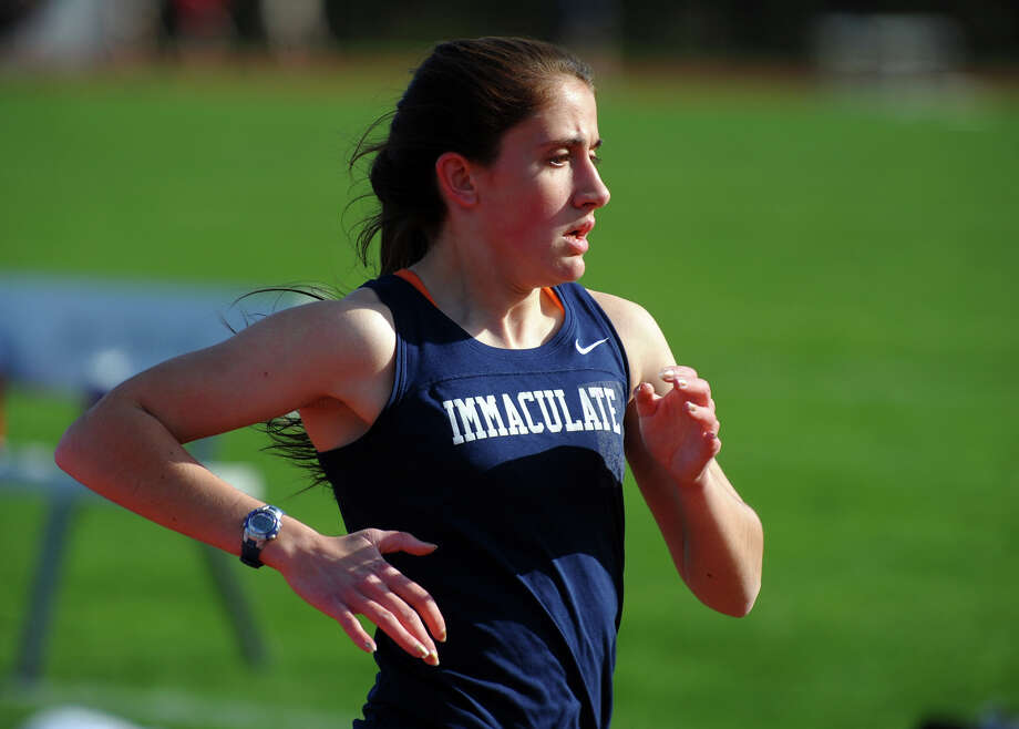 Immaculate's Jessica Wojnicki competes in the 1600 meter race, during track action at Barlow high in Redding, Conn. on Tuesday April 30, 2013. Photo: Christian Abraham / Connecticut Post