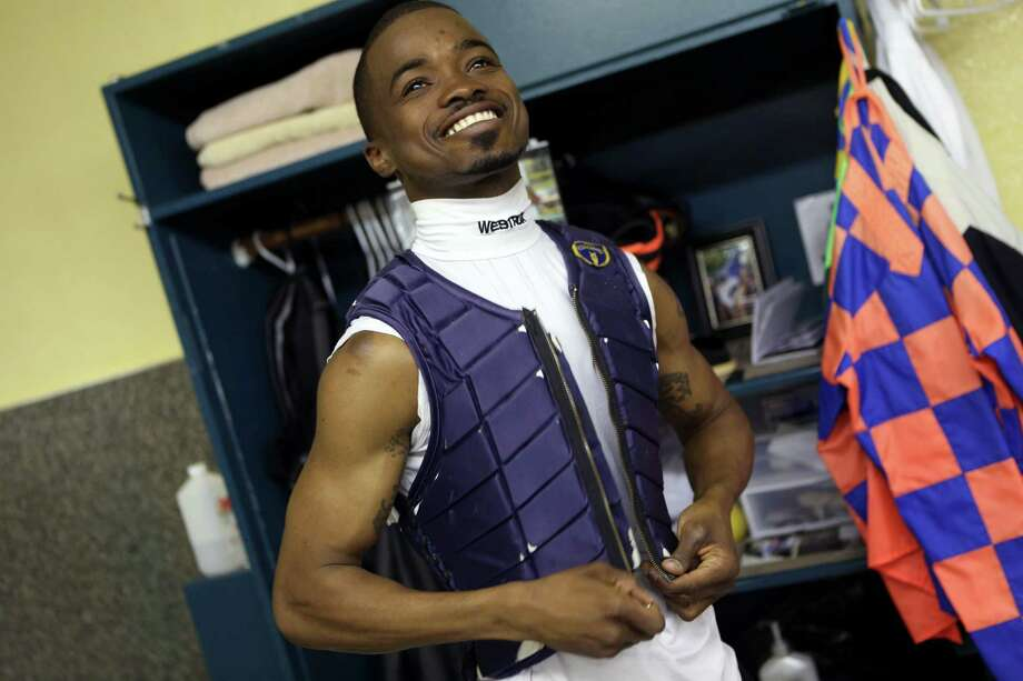 Kevin Krigger, a jockey, prepares for his first race of the day at Santa Anita Park in Arcadia, Calif., April 20, 2013. Krigger is poised to become the first black jockey to ride in the Kentucky Derby since 2000. (Ann Johansson/The New York Times) Photo: ANN JOHANSSON / NYTNS
