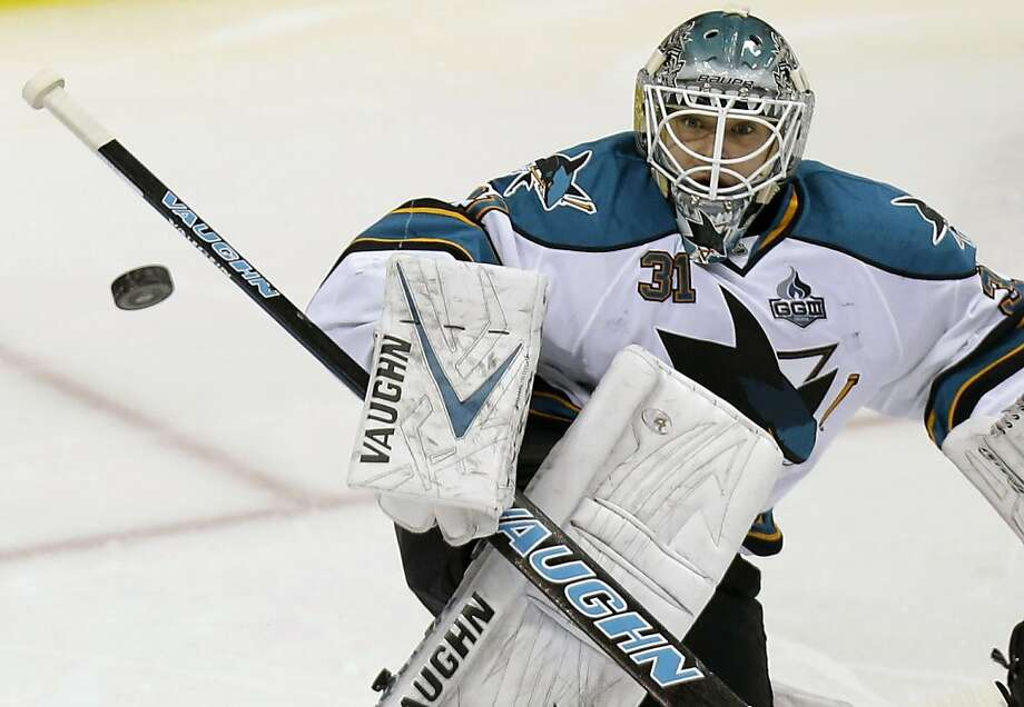 Sharks goalie Antti Niemi was in net each time his team played the Canucks this season, and San Jose won all three games. Photo: LM Otero, Associated Press