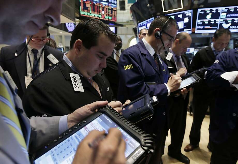 Traders on the floor of the New York Stock Exchange. Opinions differ on the tech sector; bulls call it undervalued, and bears say tech spending will fall. Photo: Richard Drew, Associated Press