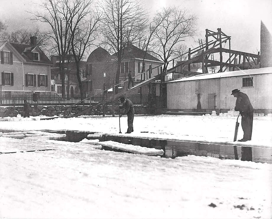 Circa 1909: Employees of the Diamond Ice Company harvest ice from the Mill Pond. Photo contributed by the Stamford Historical Society. Photo: Contributed Photo, ST / Stamford Historical Society