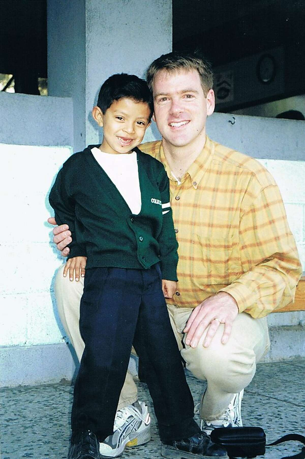 """Researcher Bruce Wydick poses with a child at the San Pedro La Laguna, Guatemala Compassion International site that was included in the study """"Does International Child Sponsorship Work? A Six-Country Study of Impacts on Adult Life Outcomes"""". Wydick is the lead author of the study, which was published in the April issue of the Journal of Political Economy."""
