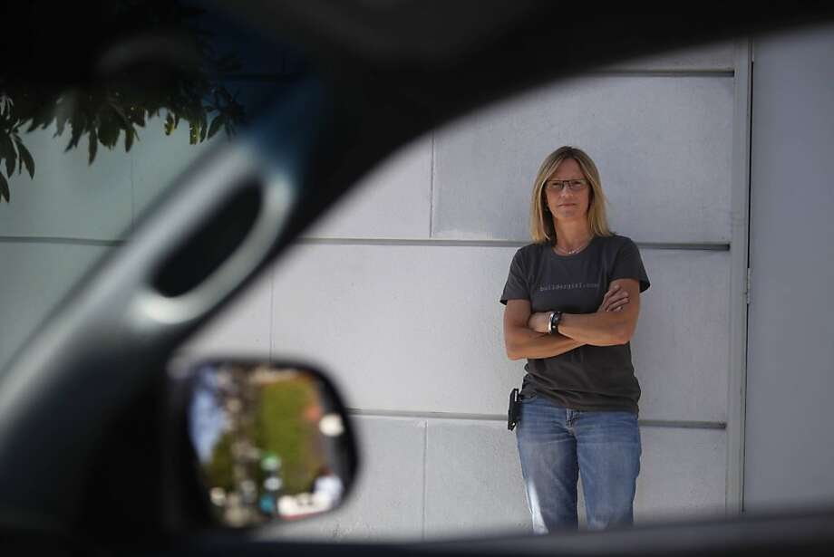 Tina Humphrey of Mill Valley, who was held at gunpoint on Monday by Jeffrey Boyce, is seen through the open windows of her pickup truck on Tuesday, April 30, 2013 in San Francisco, Calif. Photo: Lea Suzuki, The Chronicle