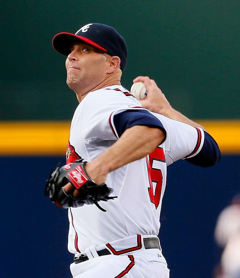 ATLANTA, GA - APRIL 30:  Tim Hudson #15 of the Atlanta Braves pitches in the first inning to the Washington Nationals at Turner Field on April 30, 2013 in Atlanta, Georgia.  (Photo by Kevin C. Cox/Getty Images) Photo: Kevin C. Cox, Getty Images