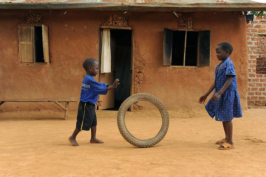 Nicholas (left), 4, and his sister play at their home in Uganda. Nicholas is part of Compassion International. Photo: Chuck Bigger, Compassion International