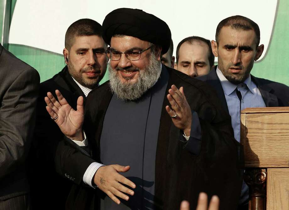 Hezbollah leader Sheik Hassan Nasrallah, seen here in Beirut in September, says his militant group would intervene in Syria on the side of the Assad government if needed. Photo: Hussein Malla / Associated Press
