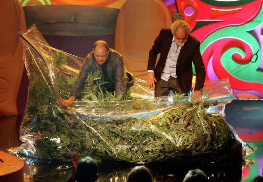 Cheeba  Cheech Marin (L) and Tommy Chong emerge from a prop bag of marijuana as they arrive for their roast at The Comedy Festival at Caesars Palace November 21, 2008 in Las Vegas, Nevada. Photo: Ethan Miller, Getty Images / 2008 Getty Images