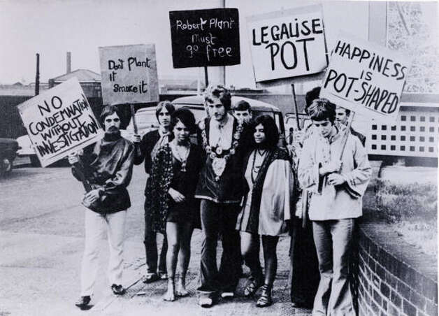 Pot Singer Robert Plant, later of Led Zeppelin (center), and fellow Band Of Joy members John Elson (far left), Steve Taylor (2nd left), and Dave Evans (far right) pose with a group of drugs protesters holding pro-pot banners, circa late 1967 in England. Photo: GAB Archive, Redferns / Redferns