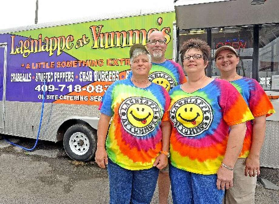 From left to right; Robin Cappel, Davis Smith, Cyd Cappel, and Megan Stelly stand outside the Lagniappe at Yummo's food truck at 5213 Twin City Highway in Port Arthur.  Randy Edwards/cat5
