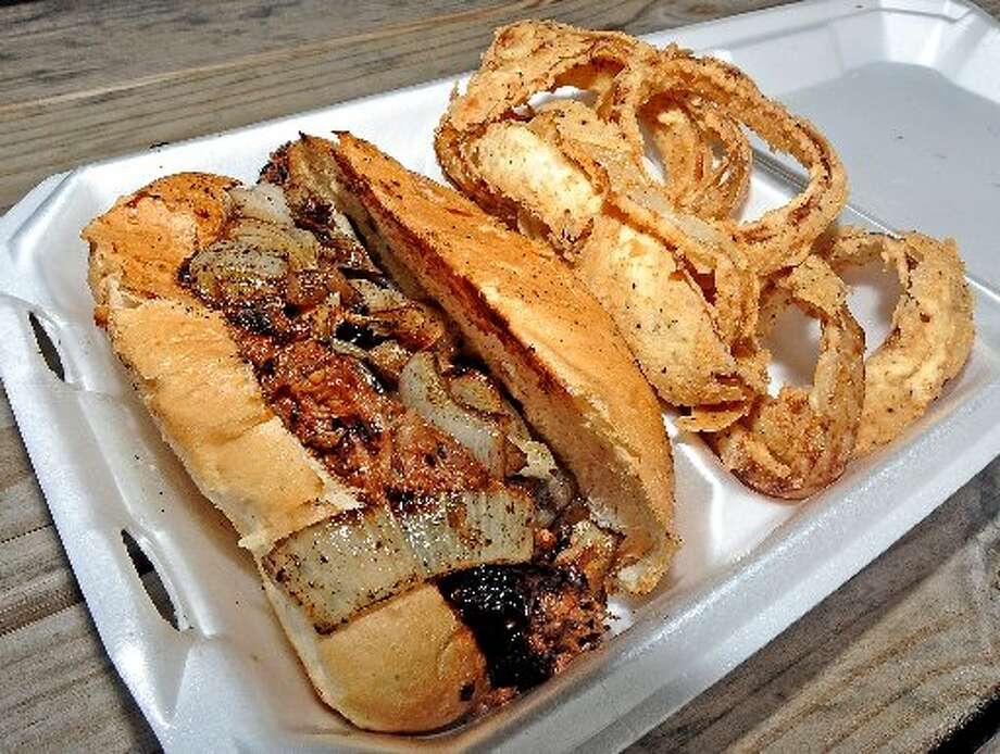 Pulled pork sandwich and homemade onion rings at Lagniappe at Yummo's. Randy Edwards/cat5