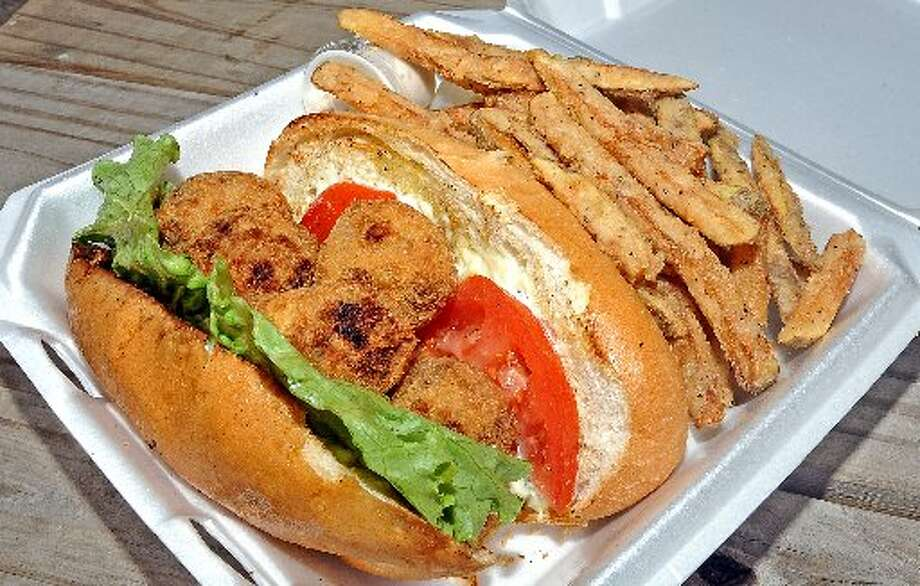 Crab ball poboy and fries. Randy Edwards/cat5