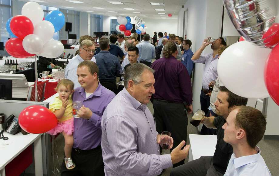 Employees of the Xodus Group visit during an April company party in Houston. The Scotland-based energy consulting firm has been celebrating the two-year anniversary of its operations in Houston. Photo: J. Patric Schneider, Freelance / © 2013 Houston Chronicle