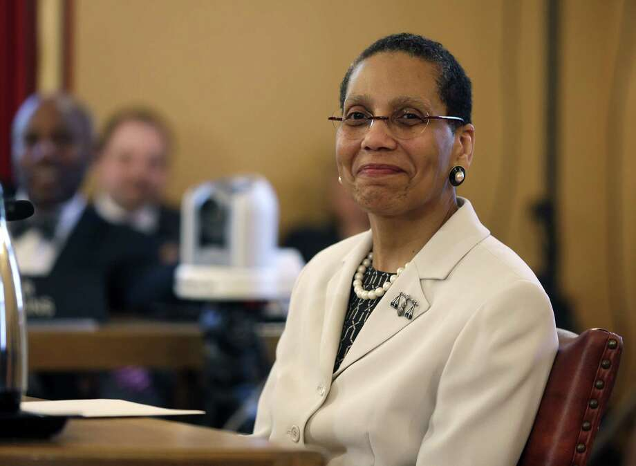 Justice Sheila Abdus-Salaam looks on as members of the state Senate Judiciary Committee vote unanimously to advance her nomination to fill a vacancy on the Court of Appeals at the Capitol on Tuesday, April 30, 2013, in Albany, N.Y. If confirmed by the full Senate, she will be the first African-American woman on the seven-member Court of Appeals.  (AP Photo/Mike Groll) Photo: Mike Groll
