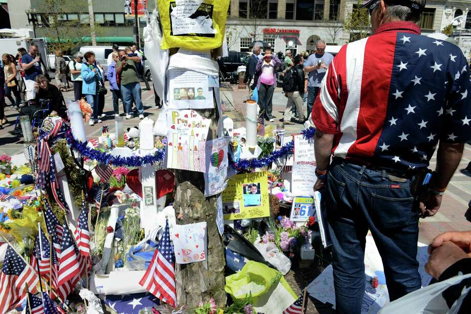 BOSTON - APRIL 30:  A man with an American flag shirt stands at the memorial site in Copley Square for the deadly attacks on the Boston Marathon on Boylston Street April 30, 2013 in Boston, Massachusetts. Boston continues to return to normalcy with Bolyston Street fully reopened and businesses back up and running following two weeks of closures.  (Photo by Darren McCollester/Getty Images) *** BESTPIX *** Photo: Darren McCollester