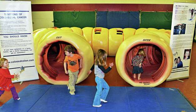 Children play on ?CoCo? a 40-foot long replica of a human colon at the Wilton Branch of the Saratoga Regional YMCA in Saratoga Springs, NY Tuesday April 30, 2013.  (John Carl D'Annibale / Times Union) Photo: John Carl D'Annibale / 10022209A