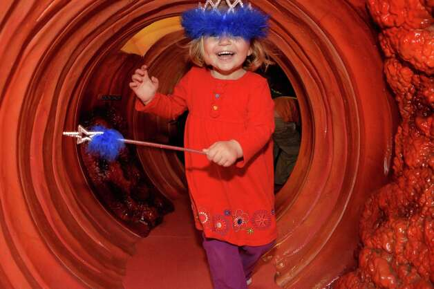 Three-year-old Eleanor Russell of Wilton runs through ?CoCo? a 40-foot long replica of a human colon at the Wilton Branch of the Saratoga Regional YMCA in Saratoga Springs, NY Tuesday April 30, 2013.  (John Carl D'Annibale / Times Union) Photo: John Carl D'Annibale / 10022209A
