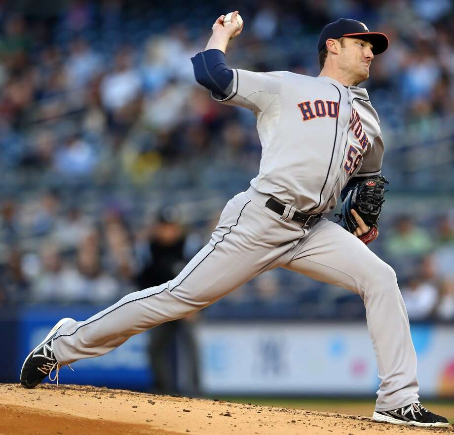Astros starting pitcher Philip Humber delivers a throw against the Yankees. Photo: Elsa, Getty Images